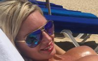 Hot blonde topless at the beach enjoying the sun